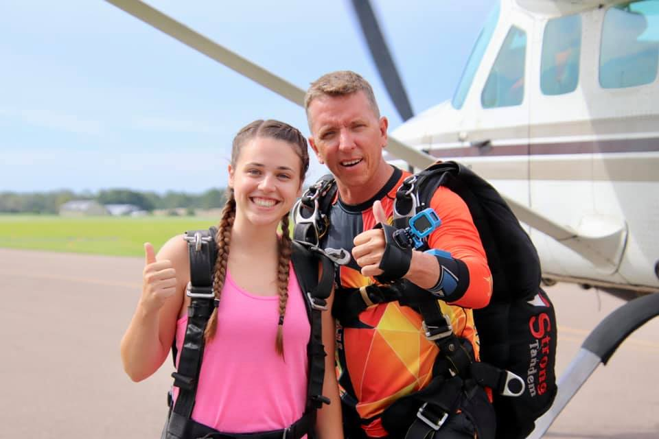 first time jumper taking skydiving pictures and videos with uspa certified tandem instructor