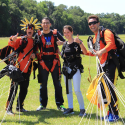 Celebrating their safe tandem skydive near Tampa Florida