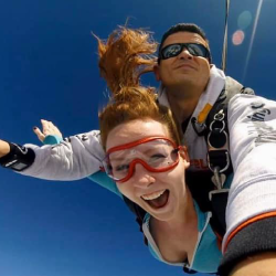 Female tandem jumper enjoying free fall